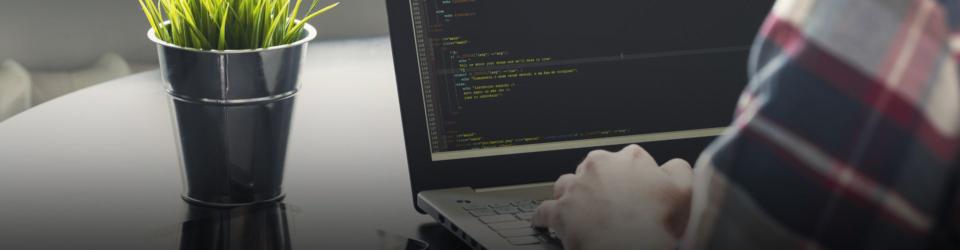 Programmer working at his laptop with solutions that help increase his productivity