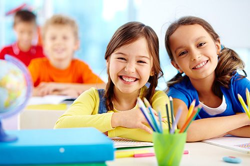 Happy kids at a school with an efficient document management system for education