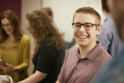 A smiling HelpSystems employee