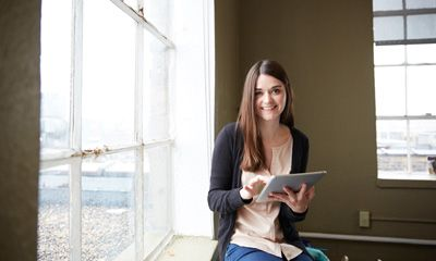 A business user gets data access on her tablet